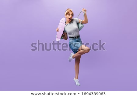attractive young woman in a denim skirt stock photo © acidgrey