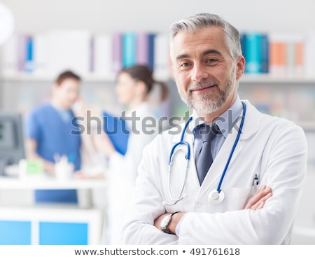 happy and confident doctor posing arms crossed stock photo © stockyimages