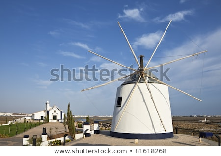 Old windmill in Algarve, Portugal stock photo © gvictoria