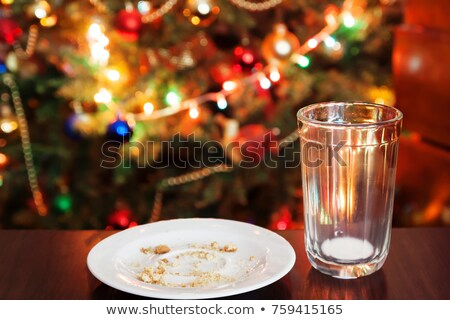 Christmas Cookie Crumbs and Empty Milk Glass on Table Stock photo © saje