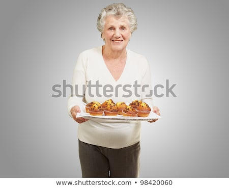 Gourmet. Woman Holding Unhealthy Food - Appetizing Chocolate Muffin Stock photo © gromovataya