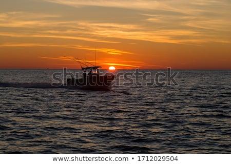 Fishing boat at sunset Stock photo © emattil