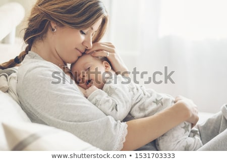 Bébé yeux beauté lit drôle blanche Photo stock © ongap