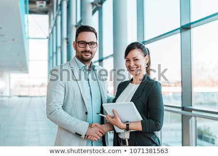 businessman - camera handshake Stock photo © dgilder