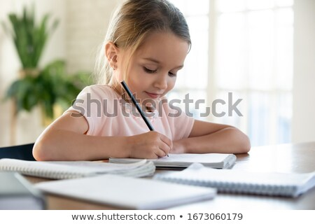 girl doing math exercise stock photo © bigandt