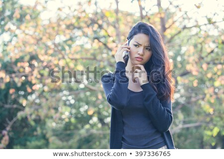 Young woman talking on mobile phone looking sad Stock photo © bmonteny