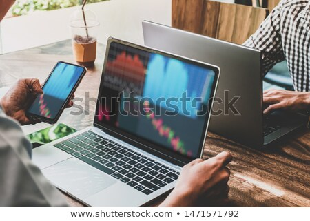 Smartphones with graph of price changes Stock photo © cherezoff