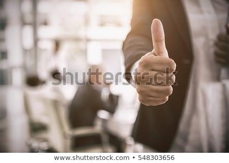 businesswoman thumbs up Stock photo © Flareimage