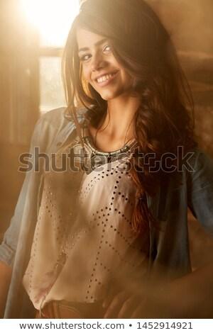 Closeup portrait of a cute tawny woman Stock photo © konradbak