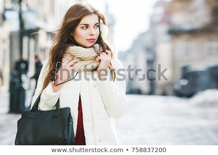Elegant woman in a black and white winter outfit Stock photo © juniart