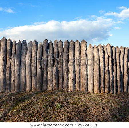 old wooden fence against blue sky with clouds stock photo © inxti