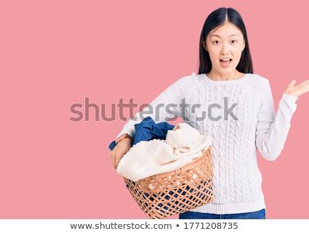 Woman holding dirty clothes   Stock photo © wavebreak_media