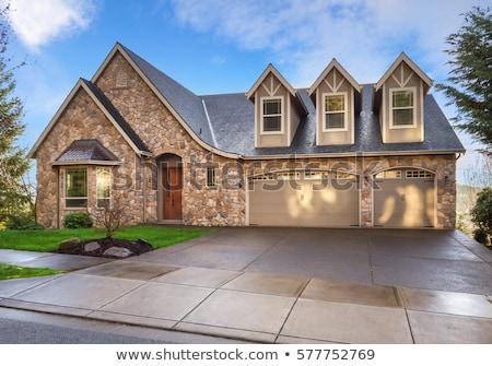Kő ház kőművesmunka kék ég ajtó ablakok Stock fotó © lunamarina