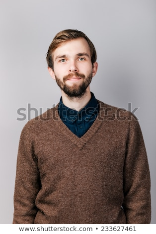 smiling young man in blue pullover portrait Stock photo © dolgachov