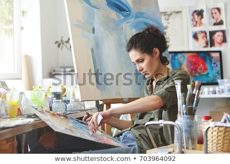 cute lovely young woman painter working in art workshop stock photo © deandrobot
