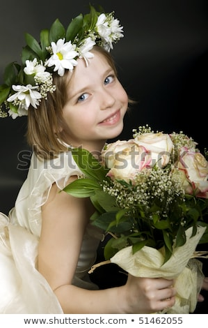 happy attractive bride in white dress and wreath of roses stock photo © deandrobot