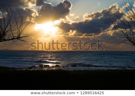 Orange sunset with rays shines through the clouds at Paphos coas Stock photo © tuulijumala