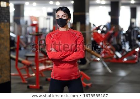 Lány pózol sportruha fiatal szőke nő fehér Stock fotó © bezikus