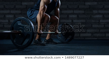 Healthy fitness guy prepare to do exercises with barbell Stock photo © deandrobot
