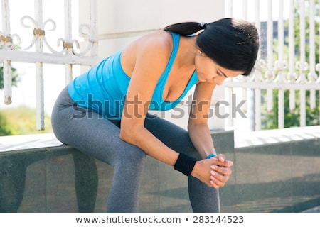 A girl sitting on the fence Stock photo © bluering