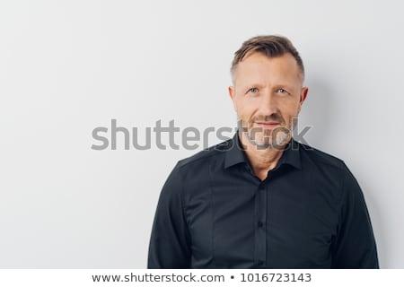 Középkorú férfi néz váll fél test portré Stock fotó © ozgur