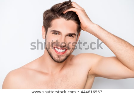 Young man touching his face with hand Stock photo © deandrobot