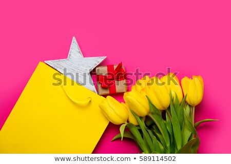 bunch of yellow tulips and beautiful star shaped toy on the wond stock photo © massonforstock