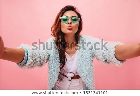 Vrouw pels hand gezicht studio Stockfoto © deandrobot