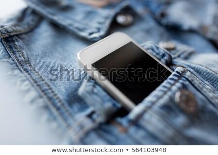 Smartphone zak denim jas vest technologie Stockfoto © dolgachov