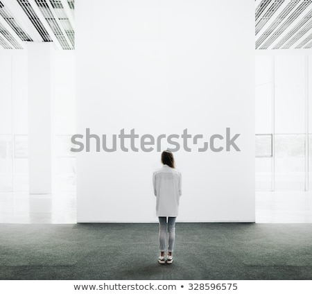 Young woman walking in museum Stock photo © deandrobot