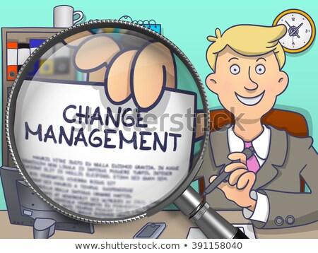 Change Management through Magnifier. Doodle Style. Stock photo © tashatuvango