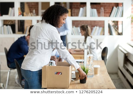 business colleagues unpack office boxes stock photo © is2