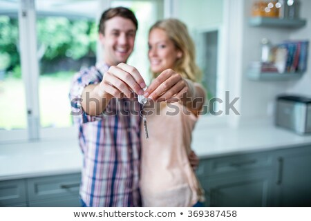 man showing a key of their new house stock photo © wavebreak_media