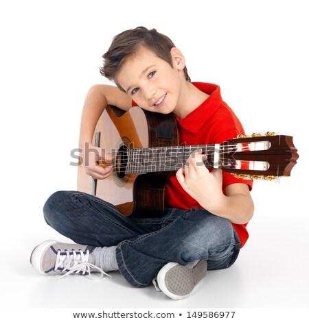 Caucásico nino cantando jugando guitarra acústica alegre Foto stock © RAStudio