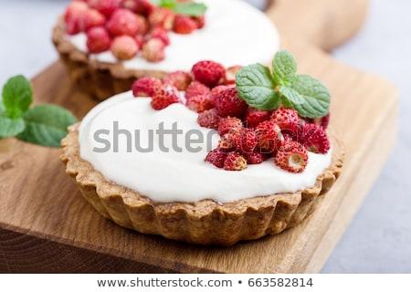 wild strawberries on wooden background stock photo © valeriy