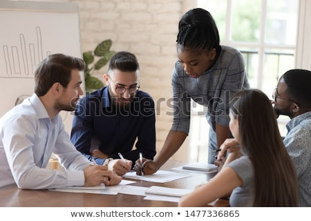 Female Architect reviewing plans Stock photo © IS2