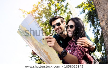 Couple reading map on roadside Stock photo © IS2