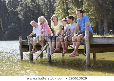 Man with grandson on jetty over lake Stock photo © IS2