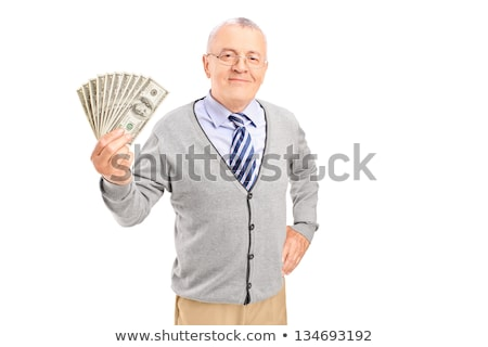 Stock photo: Portrait of a senior man holding glasses in hand