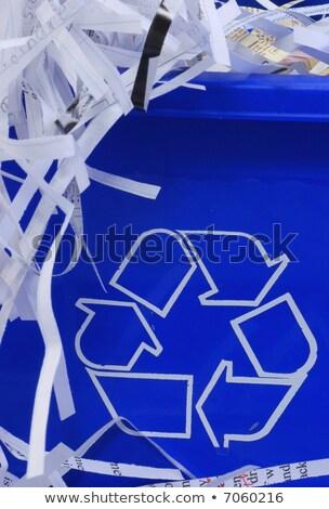 shredded paper spilling out of bin stock photo © is2