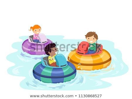 Children riding boat bumper Stock photo © bluering