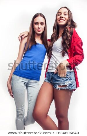счастливым два девочек позируют улыбаясь женщины Сток-фото © NeonShot
