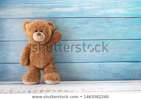 Christmas card with teddy bear on colored background Stock photo © Imaagio