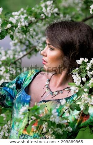 Gyönyörű lány áll virágzó fa kert érzéki Stock fotó © artfotodima