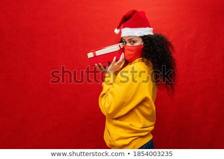 image of beautiful woman 20s wearing red sweatshirt holding lapt stock photo © deandrobot