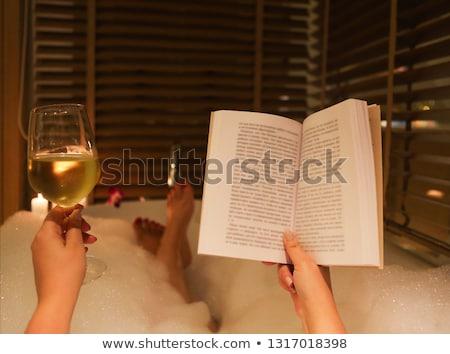 Fiatal nő iszik fehérbor fürdőkád hab gyertyák Stock fotó © dashapetrenko
