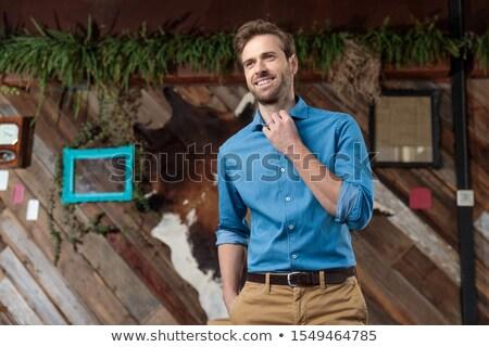 Sonriendo casual hombre pantalones lado Foto stock © feedough