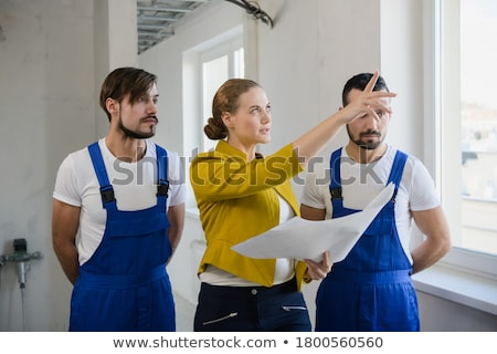 Builders crew exploring the drawings Stock photo © netkov1