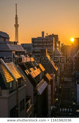 Tokió napfelkelte sziluett épület üzlet égbolt Stock fotó © vichie81
