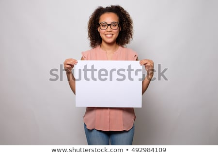 Happy girl holding a blank sign with copyspace. Stock photo © lichtmeister